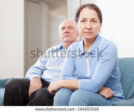 Senior couple having problems at home   - stock photo