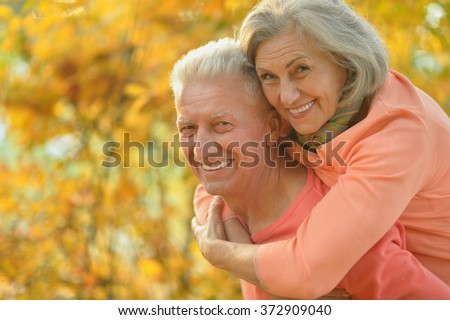 Senior couple in autumn park - stock photo