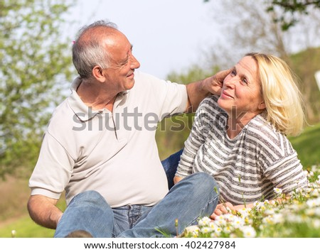 Senior couple in love enjoying togetherness outdoor.