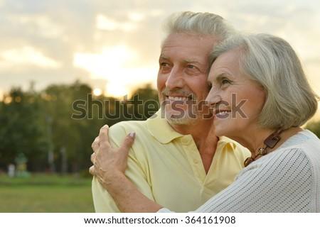 Senior couple  in summer park - stock photo