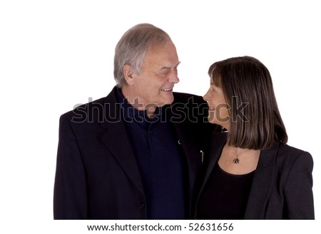 Senior couple in their 60's and 70's smiling at each other