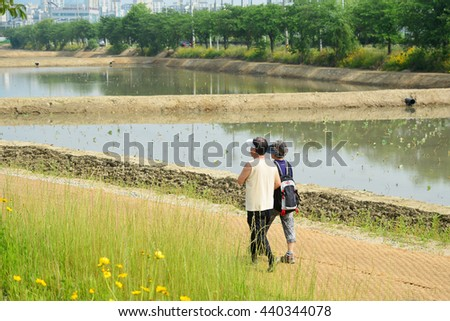 Senior Couple  jogging on a forest road in the autumn - stock photo