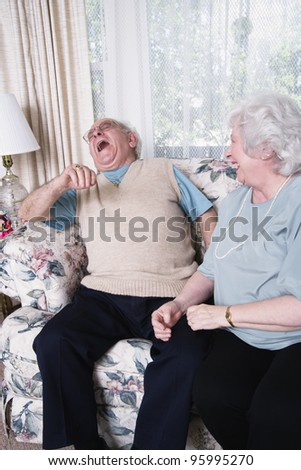 Senior couple laughing together - stock photo