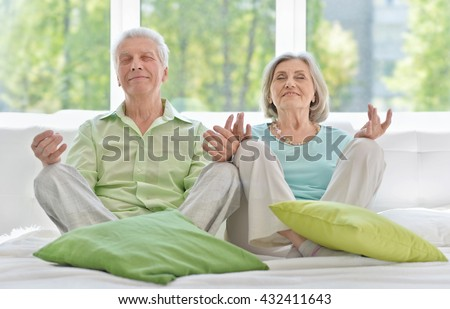 Senior couple meditating