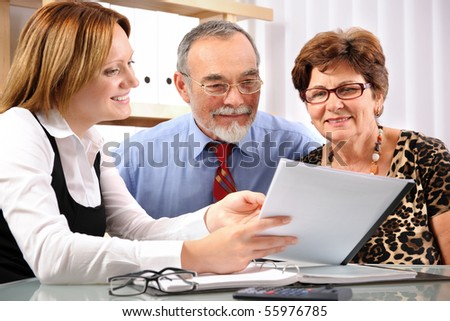 Senior couple meeting with agent or advisor