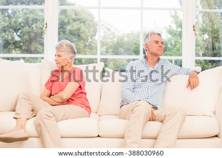 Senior couple not speaking after an argument on the sofa - stock photo