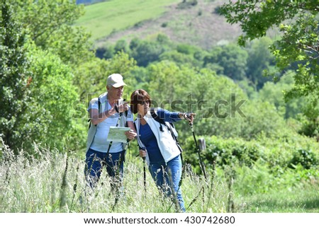 Senior couple on a hiking day in countryside