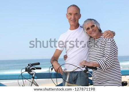 senior couple on a summer vacation - stock photo