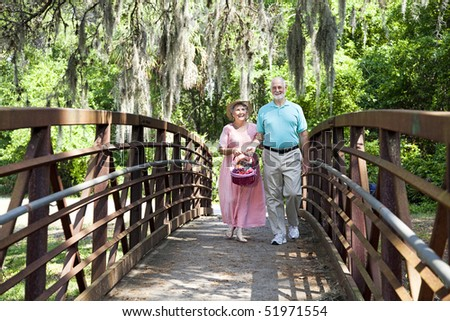 Senior couple on Florida vacation, going for picnic. - stock photo
