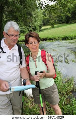 Senior couple on hiking day - stock photo