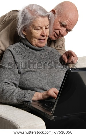 Senior couple on laptop - stock photo