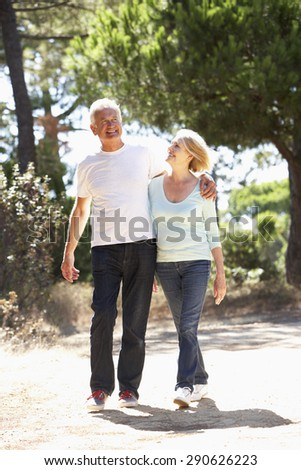 Senior Couple On Romantic Walk In Countryside