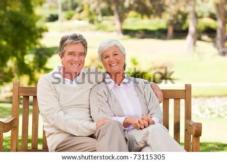 Senior couple on the bench - stock photo