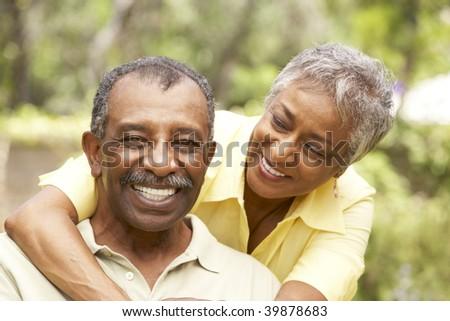 Senior Couple Outdoors Hugging - stock photo