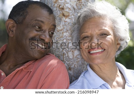 Senior couple outdoors, smiling, close-up