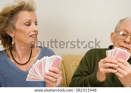 Senior couple playing cards - stock photo