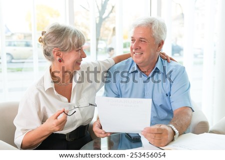 Senior couple read the form for life insurance - stock photo