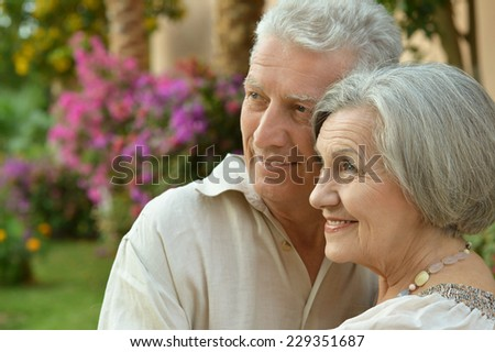 Senior couple resting on the resort during vacation