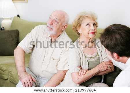 Senior couple seeing a marriage counselor, won't speak to one another.   - stock photo