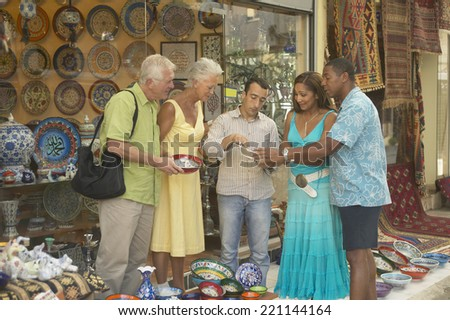 Senior couple shopping for pottery - stock photo