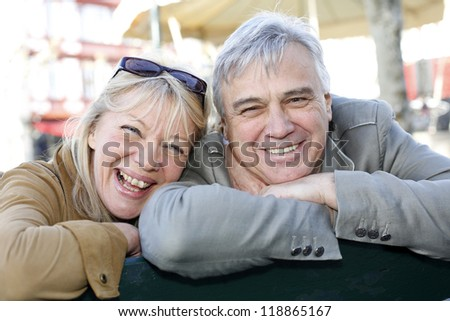 Senior couple sitting on a public bench