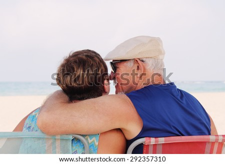Senior Couple Sitting On the Beach - stock photo