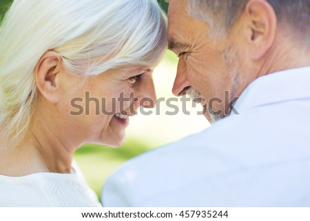 Senior couple standing outdoors