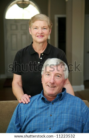 Senior couple together in their home