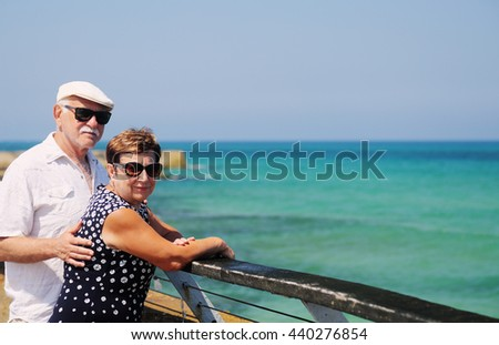 senior couple walking near the sea - stock photo