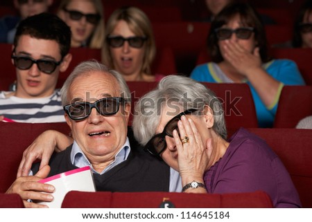 Senior Couple Watching 3D Film In Cinema