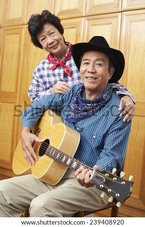 Senior Couple with Acoustic Guitar - stock photo