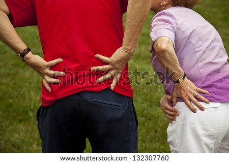 Senior couple with back and hip pain - stock photo