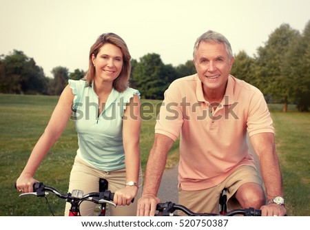 Senior couple with bicycle.