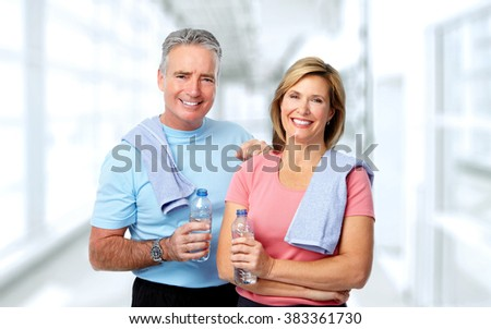 Senior couple with bottle of water.