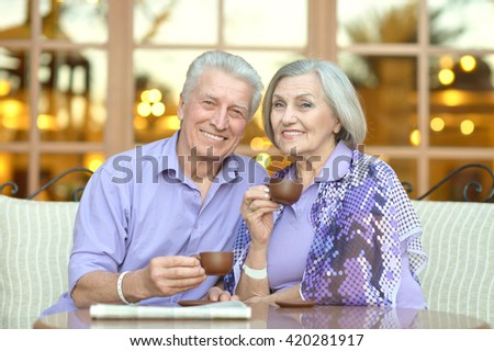 senior couple with coffee