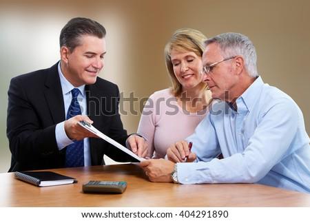 Senior couple with insurance agent. - stock photo