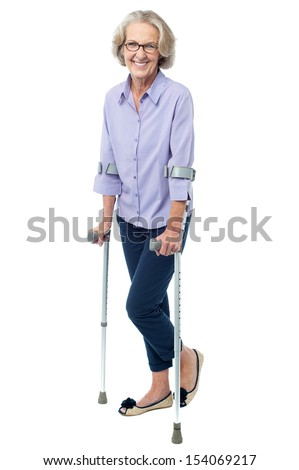 Senior courageous woman with the help of crutches