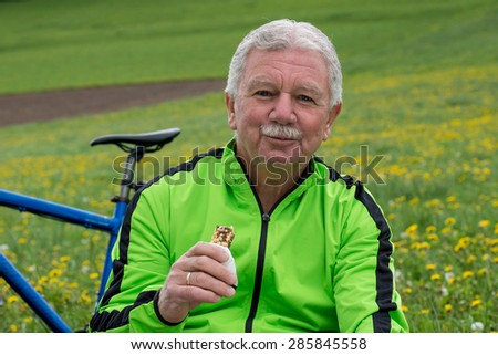 Senior cyclist enjoying nature and making a pause
