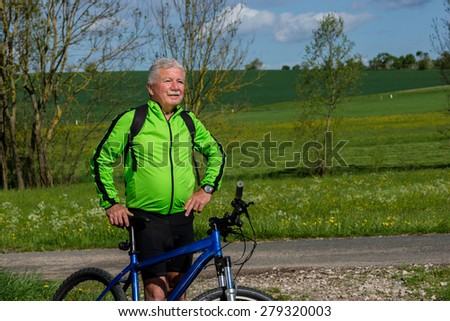 Senior cyclist in the nature
