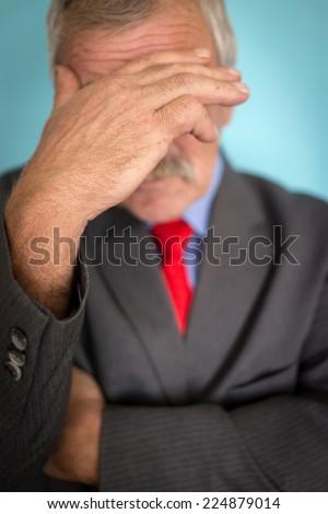 Senior depressed businessman thinking about worries - stock photo