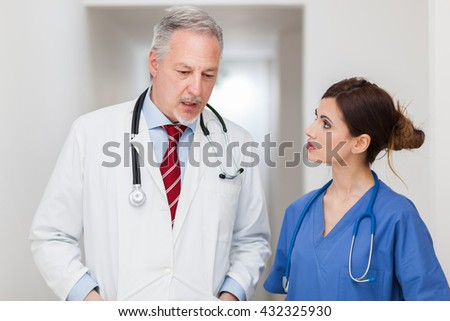 Senior doctor and nurse portrait talking