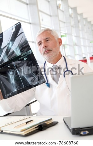 Senior doctor checking xray results