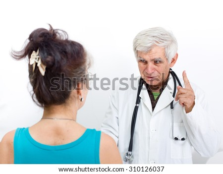 Senior doctor talking to patient, carrying stethoscope on the neck and pointing finger up