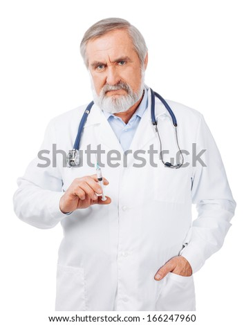 Senior doctor with a syringe isolated on white - stock photo