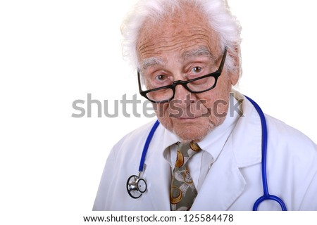 Senior doctor with gray hair wearing a white lab coat, glasses, and a blue stethoscope with kind look on his face isolated on white - stock photo