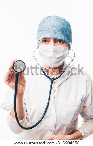 Senior doctor with mask and head cap is holding a stethoscope - isolated on white background