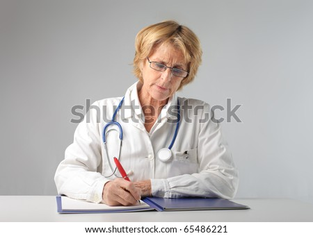 Senior doctor writing on a register