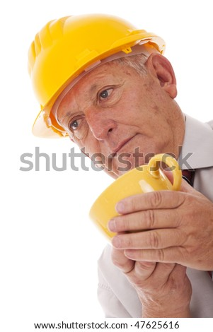 Senior engineer with a hot drink (isolated on white) - stock photo