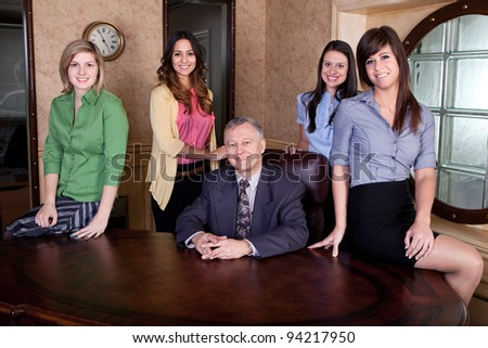 Senior executive with team of young women