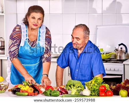 Senior family  cooking dinner at kitchen. - stock photo
